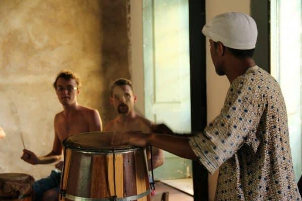 Bira Santos teaching a workshop on candomblé rhythms